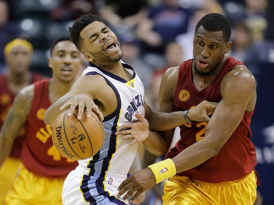 Memphis Grizzlies' Andrew Harrison is defended by Indiana Pacers' Thaddeus Young during the second half of an NBA basketball game Friday, Feb. 24, 2017, in Indianapolis. Indiana defeated Memphis 102-92. (AP Photo/Darron Cummings)