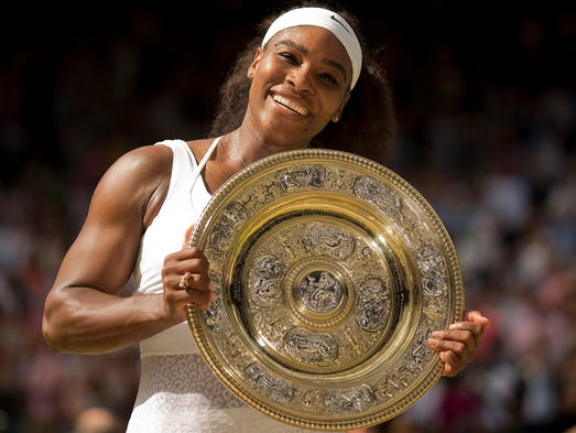 Serena Williams poses at the trophy presentation after