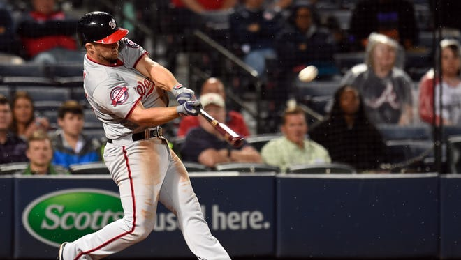 Nationals second baseman Dan Uggla hits a three-run home run.