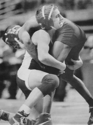 MARCH 10, 1991: Fairfield's Willie Wineberg tries to lift Princeton's Quincy North during their state championship match Saturday. Wineberg won.