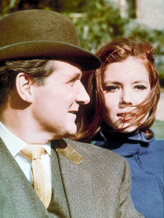 "This 1966 photo shows Patrick Macnee, left, as John Steed and Diana Rigg as Emma Peel in a scene from ""The Avengers."" Macnee, 93, died Thursday."