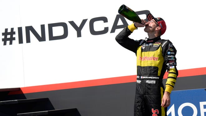 Sebastien Bourdais (18) celebrates after winning the IndyCar Firestone Grand Prix of St. Petersburg Sunday, March 11, 2018, in St. Petersburg, Fla. (AP Photo/Jason Behnken)
