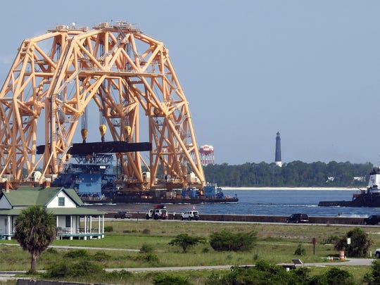 A very large piece of equipment, possibly a heavy lift crane, was towed into the Pensacola Bay Sunday morning morning around 10AM.  It size dwarfed the building around Ft. Pickens as is passed by.