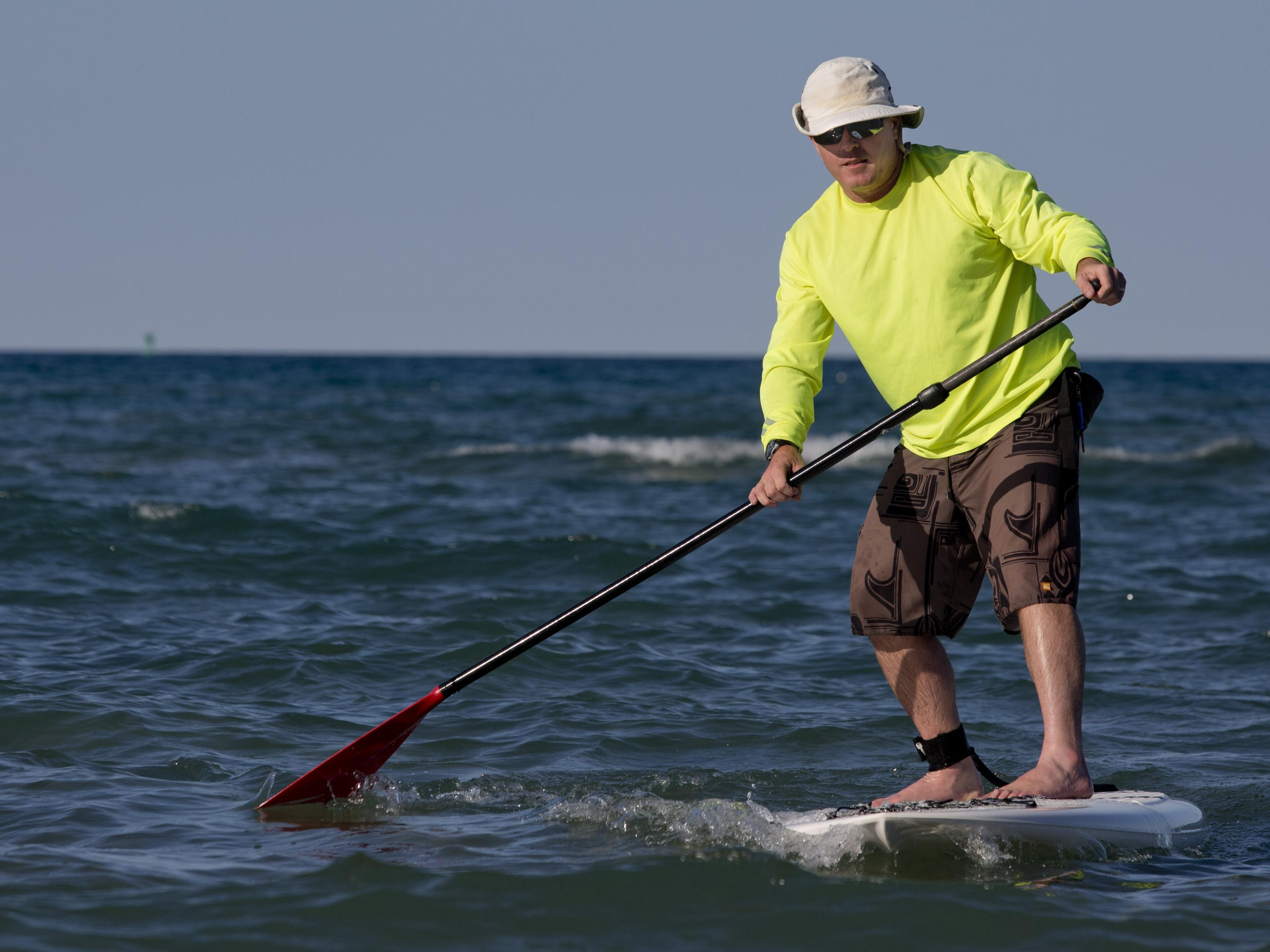Instructor Eric Isaacson paddles during a stand up paddle board class Wednesday at Lakeside Beach in Port Huron.