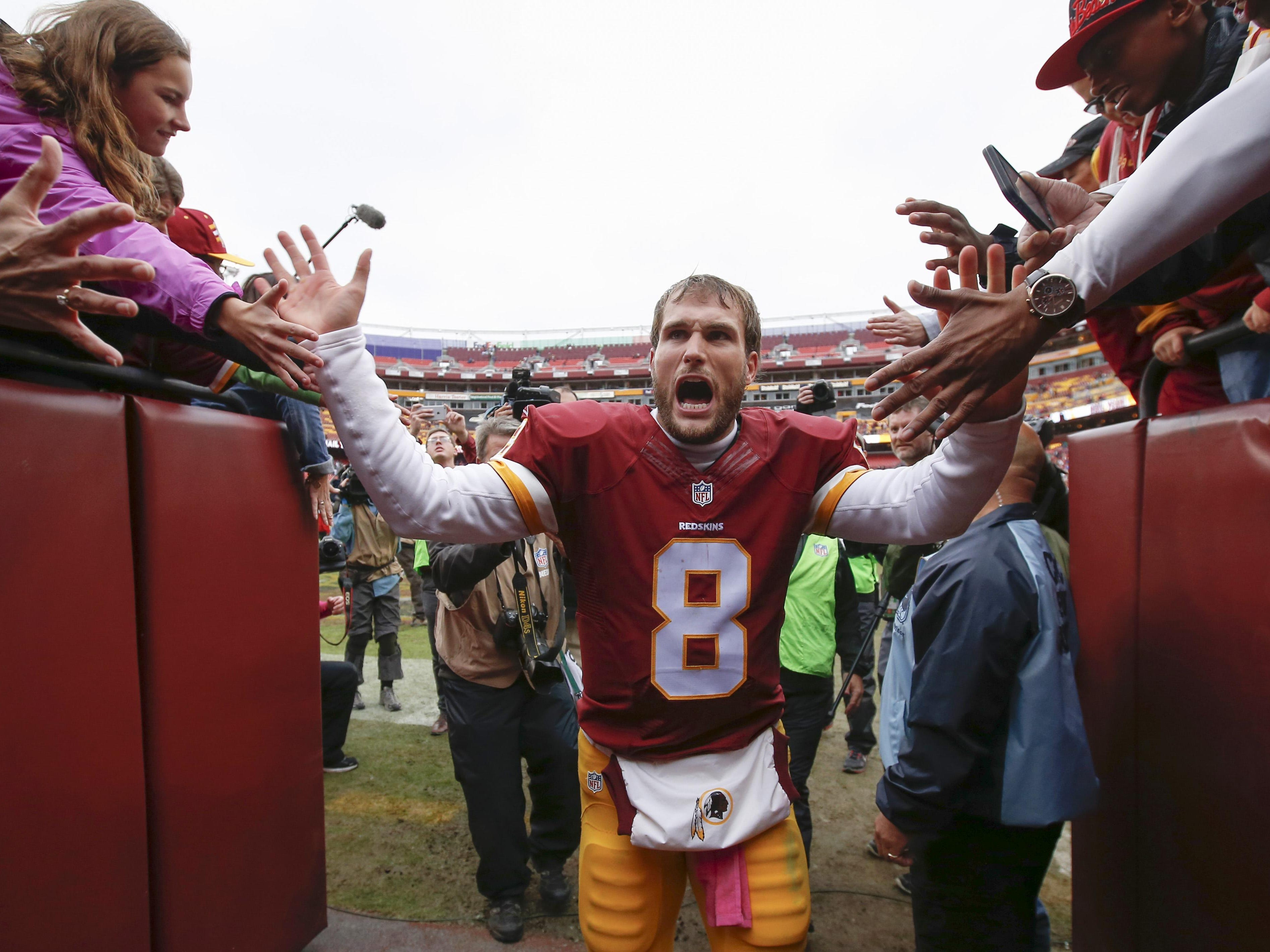 Kirk Cousins celebrates Oct. 4 as he leaves the field after the Redskins beat the Eagles, 23-20. He threw the winning TD with 26 seconds left.
