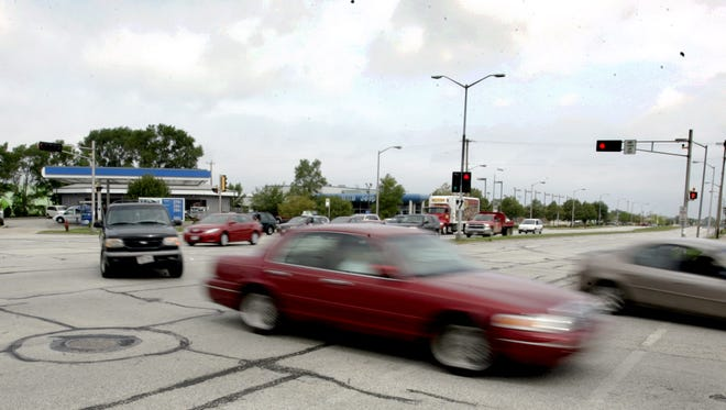 Highway 100 will be resurfaced rather than widened in West Allis and Greenfield, it was learned last week.