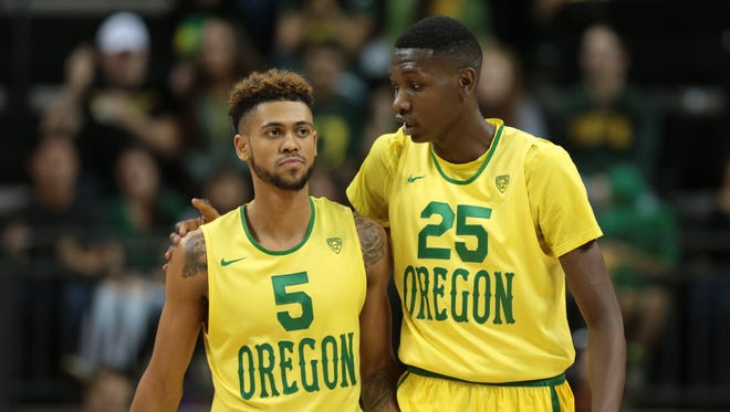 Jan 23, 2016; Eugene, OR, USA; Oregon Ducks guard Tyler Dorsey (5) and forward Chris Boucher (25) talk between plays against the UCLA Bruins at Matthew Knight Arena. Mandatory Credit: Scott Olmos-USA TODAY Sports