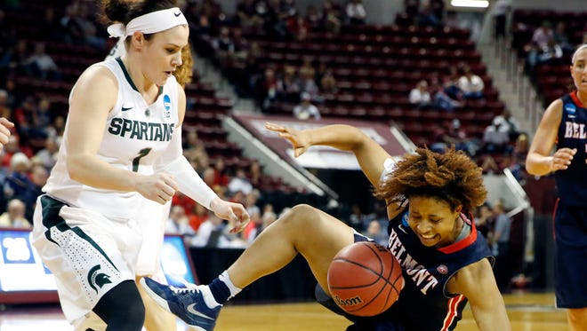 Belmont guard Sierra Jones is upended by Michigan State defender Tori Jankoska, left, during the first half of a first-round game in the NCAA women's basketball tournament Friday, March 18, 2016, in Starkville, Miss.