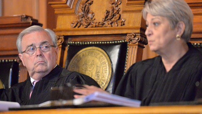 From left, Kentucky Chief Justice John D. Minton Jr., listens as Justice Mary C. Noble asks a question during oral arguments in a case that seeks clarification on what a judge is allowed to do when a jury lacks diversity Thursday in the Kentucky Supreme Court Courtroom in Frankfort Ky. (Timothy D. Easley/Special to the C-J)