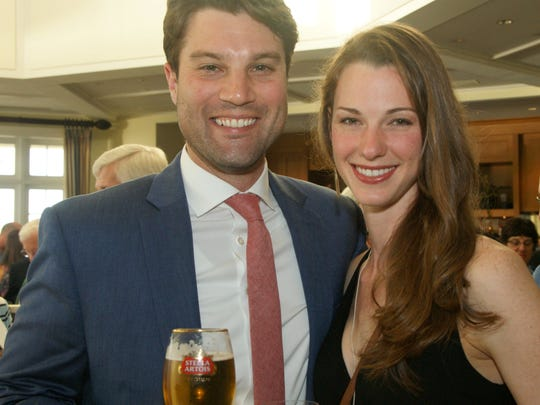 "Beckett Horner and Jennifer Nedimyer attend the Youth Sailing Foundation's ""Rock The Boat"" gala at the Moorings Yacht & Country Club on March 18."