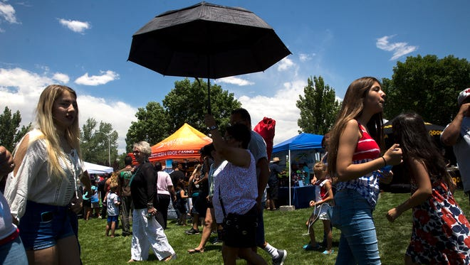 Party in the Park visitors take in the action Tuesday at Brookside Park in Farmington.