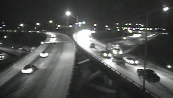 A dusting of snow covers roads at I-71/75 at I-275 early Friday. A crash closed the ramp from I-275 W to I-71/75 S just before 5:30 a.m.