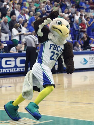 FGCU's mascott Azul runs around the court while pumping up the crow for a women's basketball game between FGCU and Lipscomb.