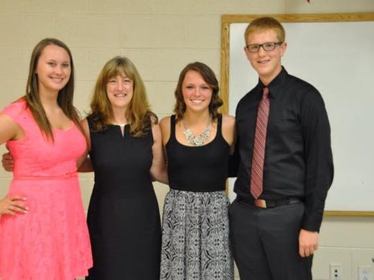 Maysville Alumni President Nancy Ragias, second from left, presented $700 scholarships to Maysville High School graduates Abby Edwards, Callie Tatman and Luke Engle.