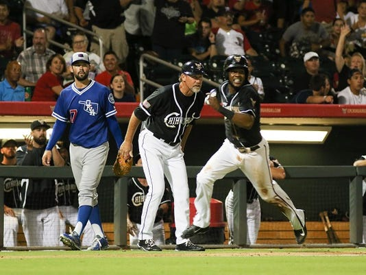 Oklahoma City Pitcher Zach Lee looks on as Chihuahuas' Manager Jamie Quirk sends Hector Gomez to home plate