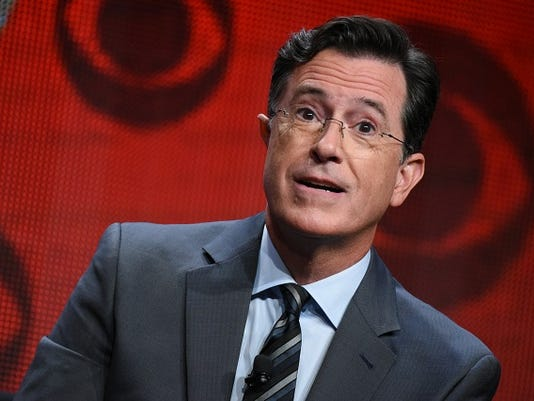 """FILE - In this Aug. 10, 2015, file photo, Stephen Colbert participates in """"The Late Show with Stephen Colbert"""" segment of the CBS Summer TCA Tour in Beverly Hills, Calif."""