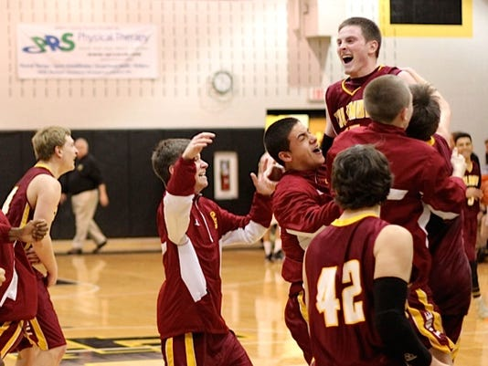 Columbia players celebrate after pulling out an exciting win over Lancaster Mennonite in the first round of the D-3 Class AA playoffs.