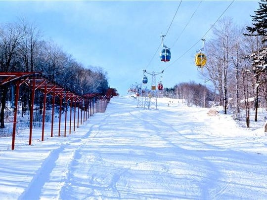 The brightly colored cabins of Mount Snow's skis-on gondola enabled skiers to keep their skis on while being protected from the elements on the ride up.