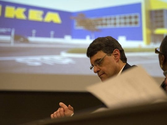 Economic Development Growth Engine (EDGE) Board President Reid Dulberger listens during a video presentation by retailer Ikea before a vote approving a property tax break for a proposed Ikea store in Memphis. The city and county mayors plan to consolidate EDGE and the Community Redevelopment Agency.