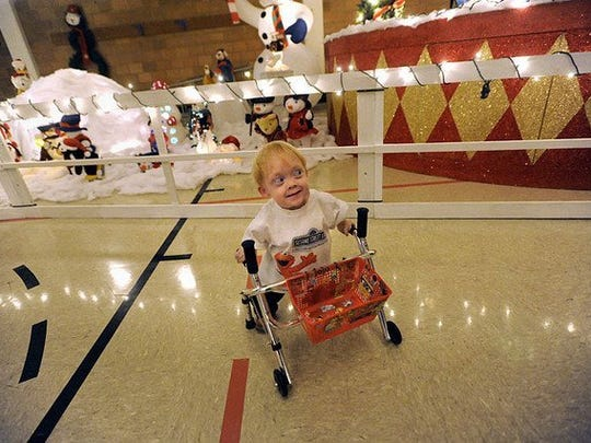 Ronald W. Erdrich/Reporter-News Brenden Baker, then 7, pushes his walker past a display at the Abilene State Supported Living Center's Winter Wonderland on Tuesday, Dec, 14, 2010. Brenden, who has a rare form of dwarfism, is featured in today's Life section.