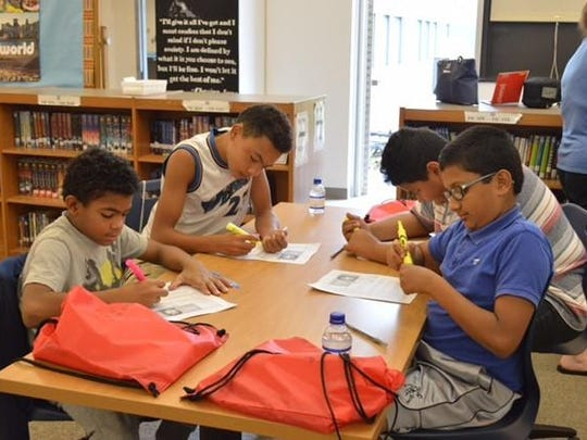 Randolph Middle School hosted a Summer Success School Readiness program to help prepare for the new school year. Pictured here left to right are Elijah Quinones, Jesse Wilfang, Abbas Bori and Jephin Philip working on a language arts project.