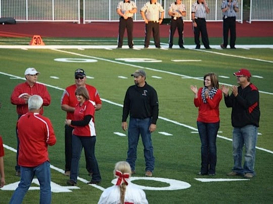 Tara and Ross Oakland, right, contributed almost $2 million to the new track and football field at Glendive.