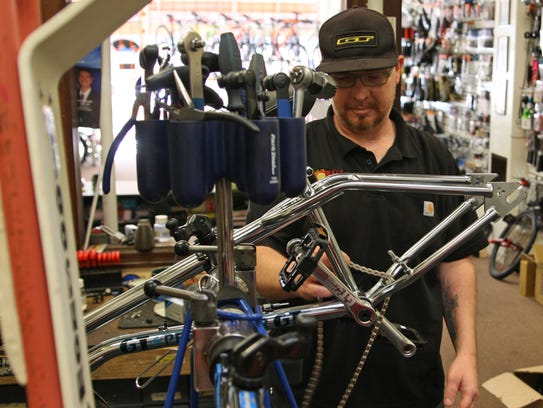 Kenny Trammell works on  a bike at Valley Bikes, 64.
