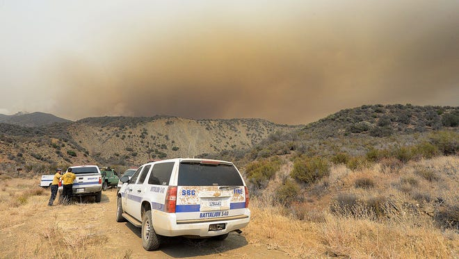Santa Barbara County crews monitor the Rey Fire burning in the Los Padres National Forest.