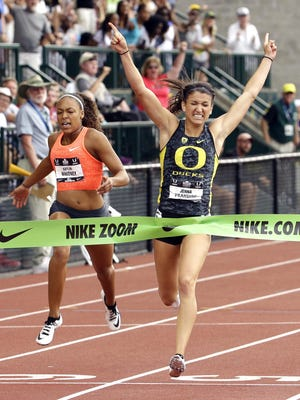 Jenna Prandini, right, wins the 200 meter race ahead of Kaylin Whitney on Sunday at the U.S. Track and Field Championships at Hayward Field in Eugene. Whitney finished fourth.