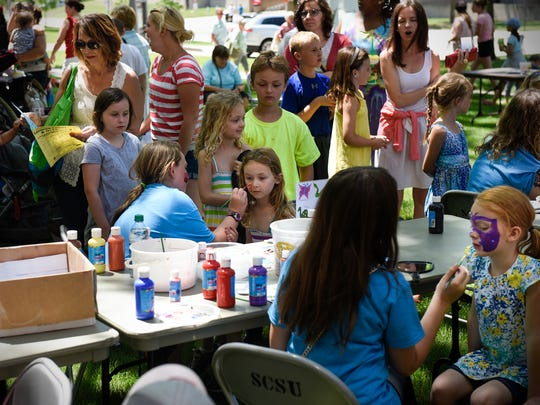 Children get their faces painted during Thursday's Lemonade Concert and Art Fair at St. Cloud State University.