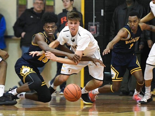 McQuaid's Harry Bruu, center, and Niagara Falls' Naim Bradley vie for a loose ball during the NYSPHSAA Class AA Far West Regional played at Greece Athena High School on Saturday, March 9, 2019. McQuaid's season ended with an 84-71 loss to Niagara Falls-VI.
