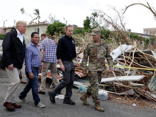 President Donald Trump takes a walking tour to survey