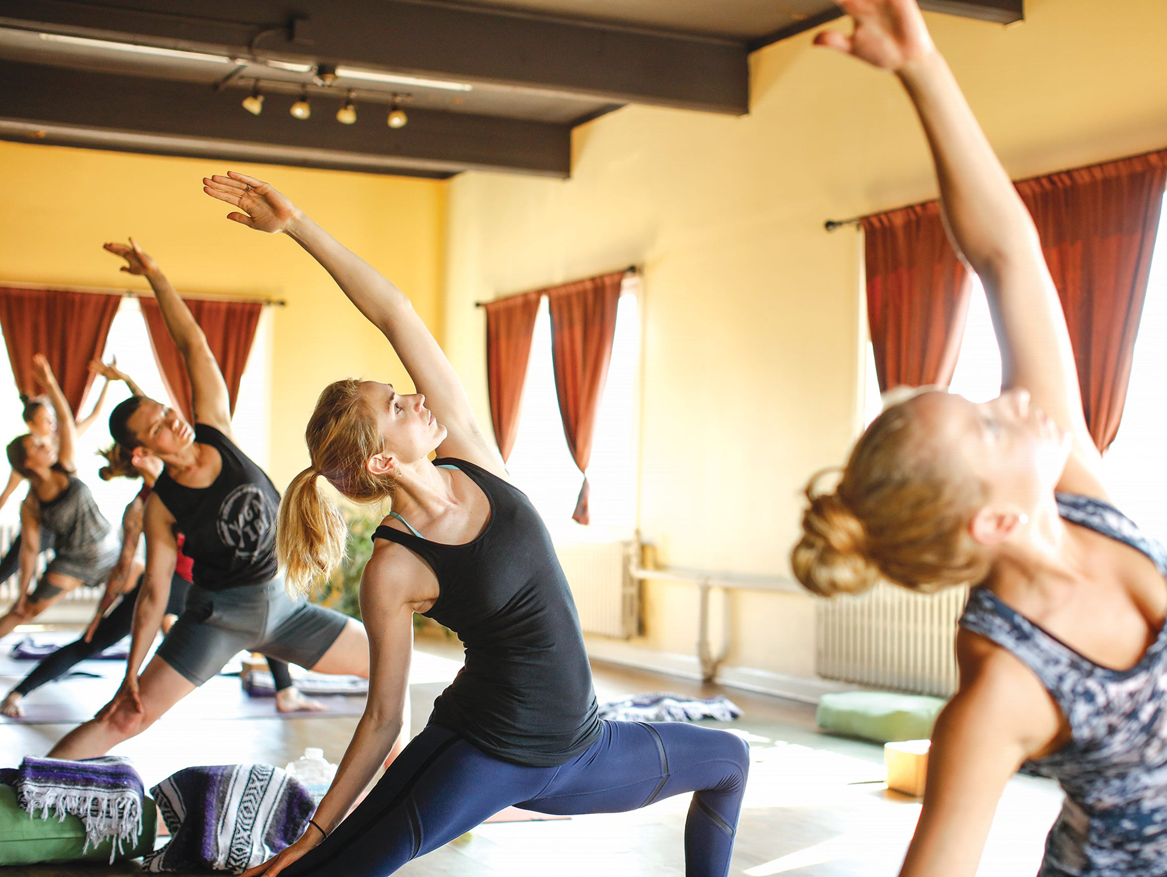 A class at YogaVibe Rochester, which offers all sorts