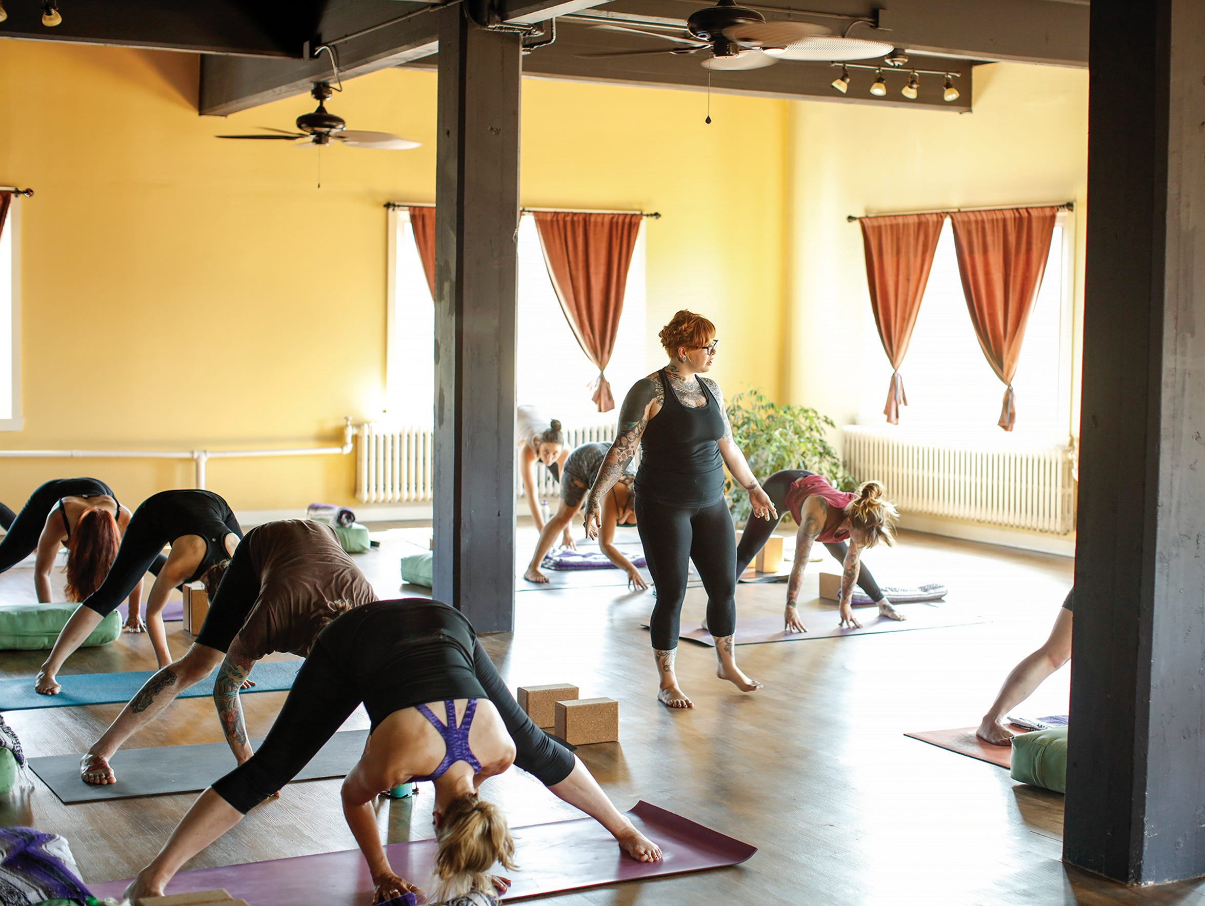 Jesse Amesmith leads a class at YogaVibe Rochester.