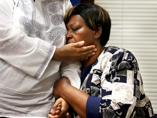 Audrey DuBose, is comforted by her daughter, Terina