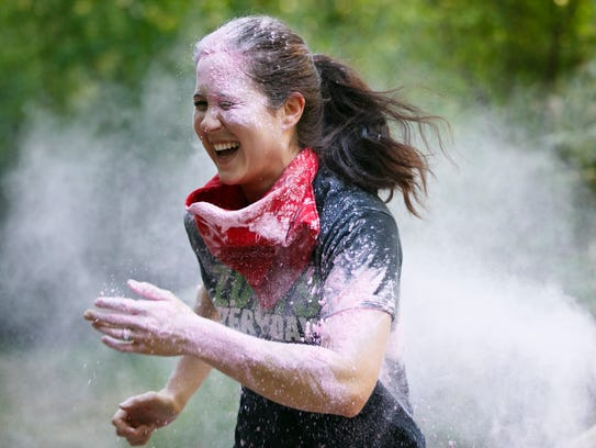 Participants are coated in colored powder at the second
