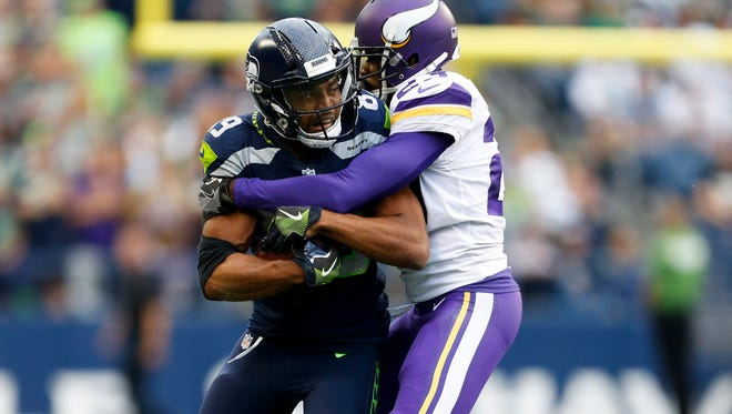 Seahawks receiver Doug Baldwin was tackled by Vikings cornerback Terence Newman after making a reception during a preseason game Aug. 17 at CenturyLink Field. Looking for an edge, Baldwin traveled to England in the offseason to receive preventative stem-cell treatment on his knees.