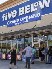 Shoppers go into the Five Below store at the Hartwell