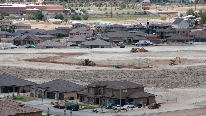 Road construction continues in a subdivision in the Little Valley area of St. George Friday, Aug. 9, 2013. Continued growth has pushed state leaders to solicit public comment as part of a statewide long-range planning process.