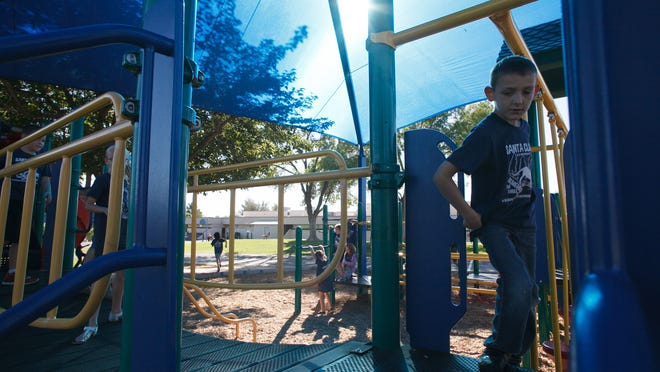 Santa Clara Elementary School students play on playground equipment beneath new large blue sun shades Friday, Oct. 10, 2014. New parks and other facilities are part of the plans for revenues expected to come in from the Recreation, Arts and Parks tax passed in Washington County last year.