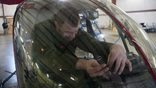 Jonathan Nobles works on wiring in one of the many helicopters at Upper Limit Aviation in Cedar City.