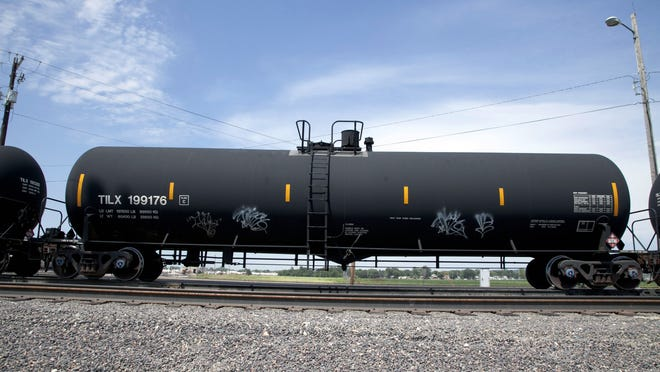 """In this Aug. 8, 2012 photo, a DOT-111 rail tanker passes through Council Bluffs, Iowa. DOT-111 rail cars being used to ship crude oil from North Dakota's Bakken region are an """"unacceptable public risk,"""" and even cars voluntarily upgraded by the industry may not be sufficient, a member of the National Transportation Safety Board said Wednesday, Feb. 16, 2014. The cars were involved in derailments of oil trains in Casselton, N.D., and Lac-Megantic, Quebec, just across the U.S. border, NTSB member Robert Sumwalt said at a House Transportation subcommittee hearing. (AP Photo/Nati Harnik, File)"""
