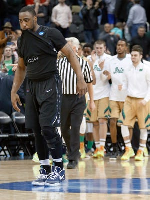Butler's Roosevelt Jones (21) bites his shirt after losing to Notre Dame in overtime of an NCAA tournament third round game, March 22, 2015,