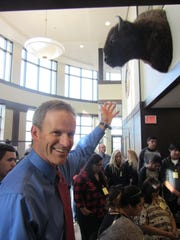 U.S. Court Judge Brian Morris points to bison mount that was blessed in ceremony  Monday at the Federal Court Building.