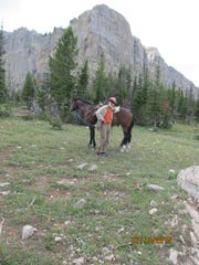 David Cameron and his equine companion stand near the Continental Divide in the Bob Marshall Wilderness.