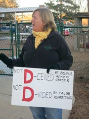 Beth Overholt, a leader in the local Opt Out movement, protests the issuance of school grades at Hartsfield Elementary.