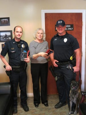 Lois Holmes recently presented Petal Police Department with 26 trauma kits. Pictured, from left, are Sgt. Josh Barham, Holmes, K9 Officer Steven Smith and K9 Dena.