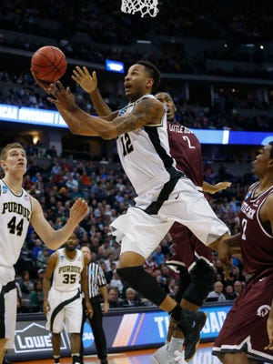 Purdue forward Vince Edwards, front, drives for a basket as Arkansas Little Rock forward Daniel Green defends in the first half of a first-round men's college basketball game Thursday, March 17, 2016, in the NCAA Tournament in Denver. (AP Photo/Brennan Linsley)