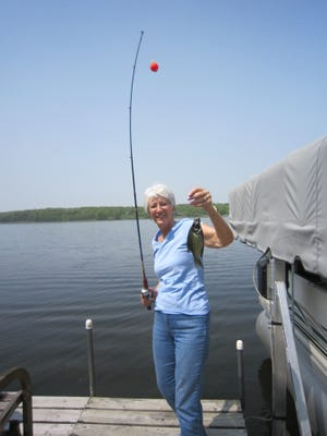 Marilyn Salzl Brinkman fishes for crappies off the dock on Mother's Day.