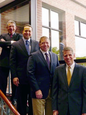 From left are Thomas Bonadio, CEO; Bruce Zicari, Rochester office managing partner and small business advisory practice leader; Robert Enright, COO; and Mario Urso, board chair and healthcare/tax-exempt practice leader.